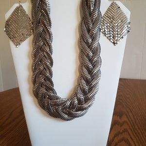 Silver toned braided necklace with silver earrings